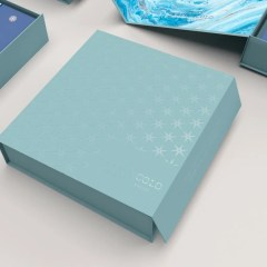 collapsible rigid box with magnetic side closure, showing stars and logo with Spot UV for extra texture