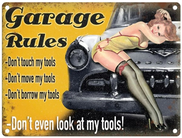 """A picture of a pin up girl with text that reads """"Garage Rules, Don't touch my tools. Don't move my tools, Don't borrow my tools, Don't even look at my tools!"""