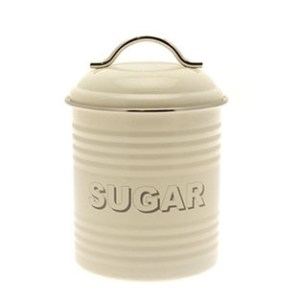 A cream coloured sugar tin with sugar written on the front