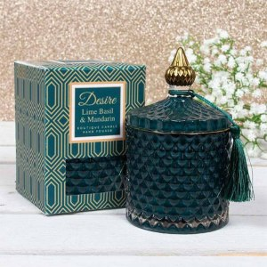 Lime candle box and deep green textured bottle with a gold lid
