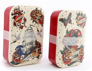 A banded lunchbox with tattoo designs printed.