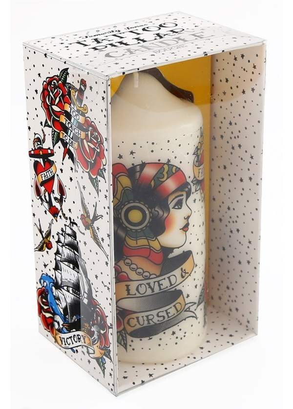 """A pillar candle with an image of a tattooed woman on the front. It's long lasting and decorative, """"Loved and Cursed"""" printed on the candle"""