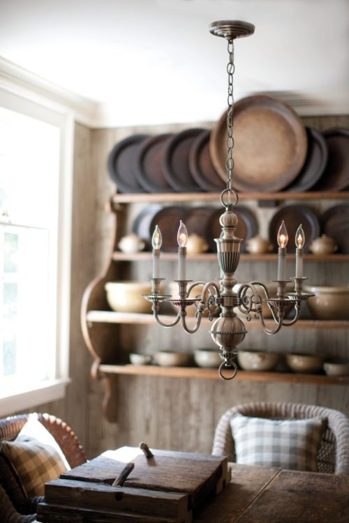 update light fixtures to vintage pieces to add character to a new home