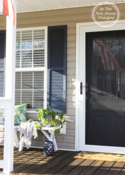 Cottage front porch with screen door