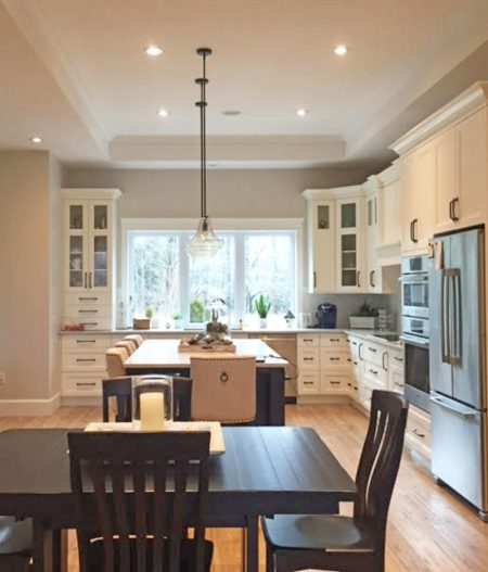 Bright white kitchen with large island