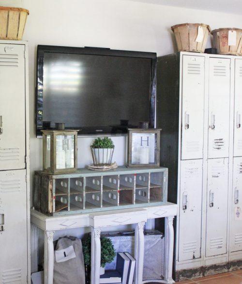 Family Room Locker Storage On TV Wall