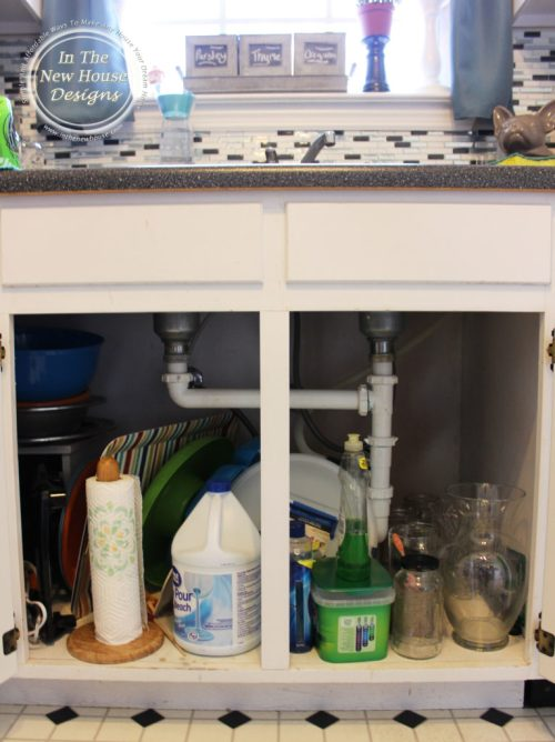 Messy Kitchen Sink Cabinet