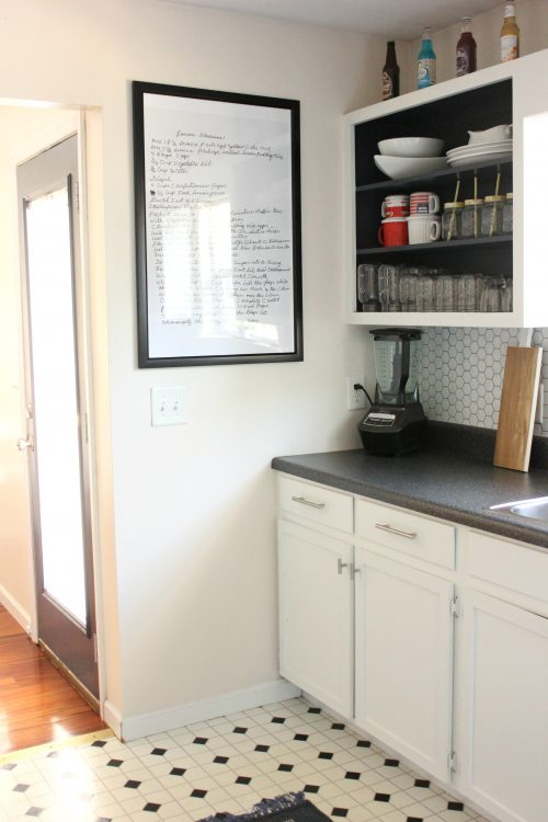 Framed recipe in kitchen and open shelving