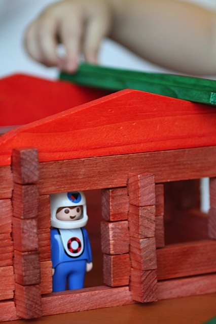 You make a Lincoln Log Cabin for your astronaut...