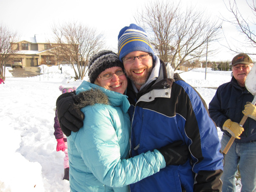 The two of us surrounded by family, building snowmen in Iowa
