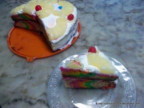 Eggless Rainbow Cake with Fresh Cream & Pineapple Cherry Frosting