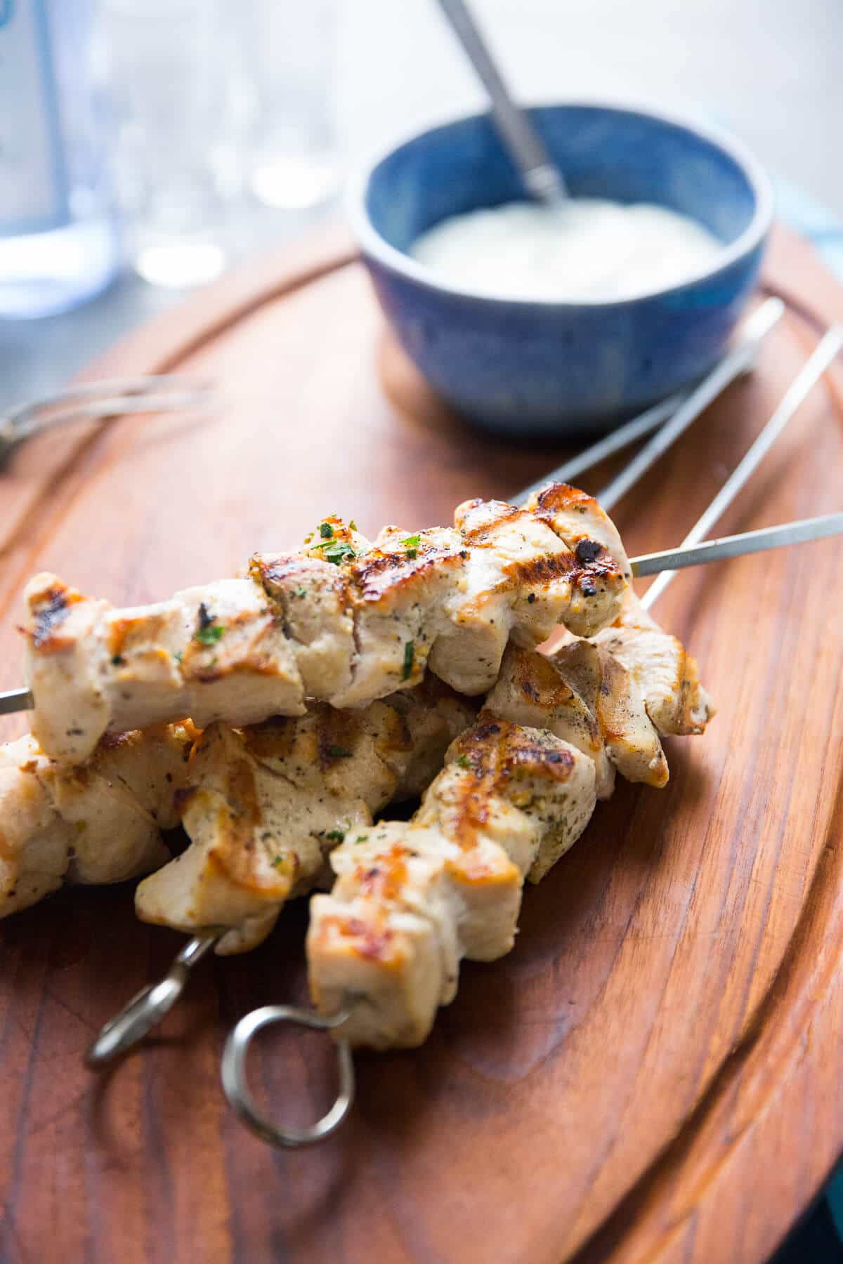 Greek chicken souvlaki recipe on the grill is a great weeknight meal option. The skewers take minutes to grill up!