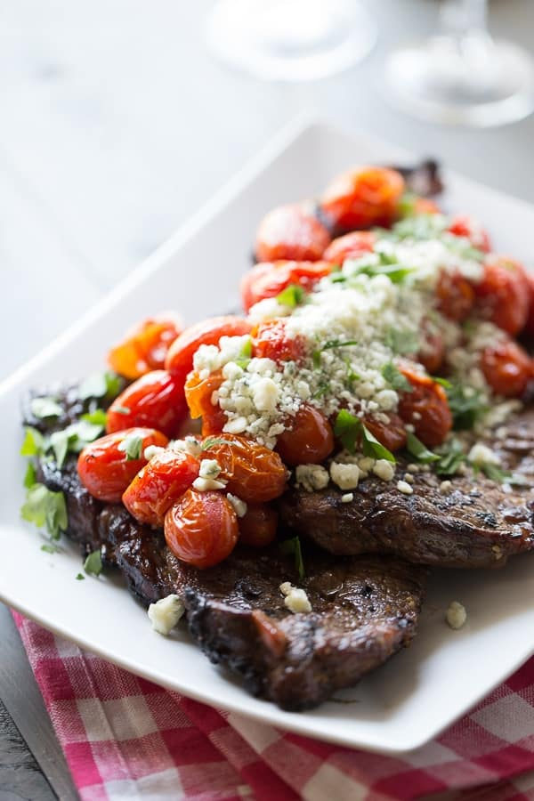 Perfectly grilled sirloin steak is covered in flavor-packed roasted tomatoes and blue cheese crumbles. lemonsforlulu.com