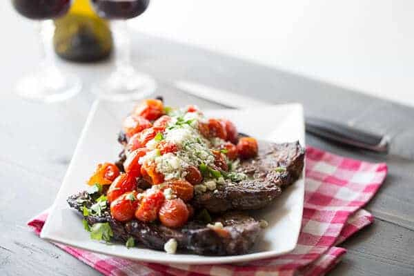 Roasted tomatoes steal the show in this simple grilled sirloin steak recipe. lemonsforlulu.com