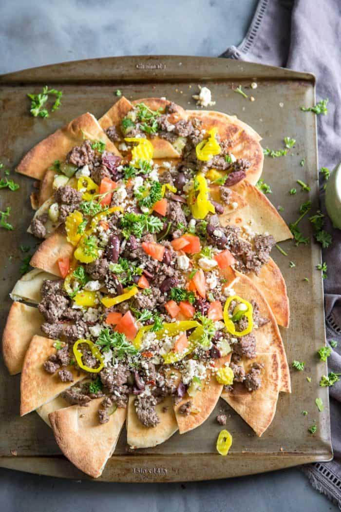 greek nachos on a baking tray
