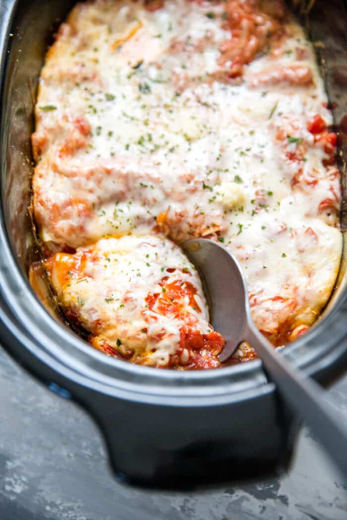 crockpot lasagna with serving spoon