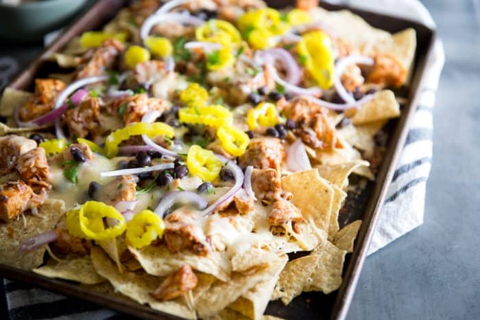 BBQ Chicken Nachos tortilla chip being grabbed
