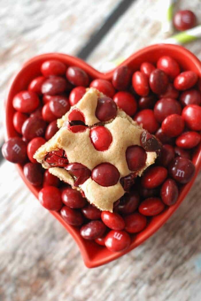"""Blondie brownies loaded with cherry M & M""""s! www.lemonsforlulu.com"""