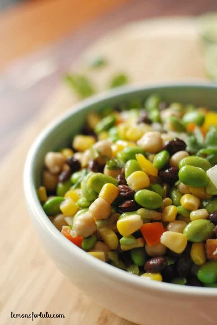 Black beans, corn, garbanzo beans and edamame are tossed with a southwestern flavored vinaigrette! www.lemonsforlulu.com