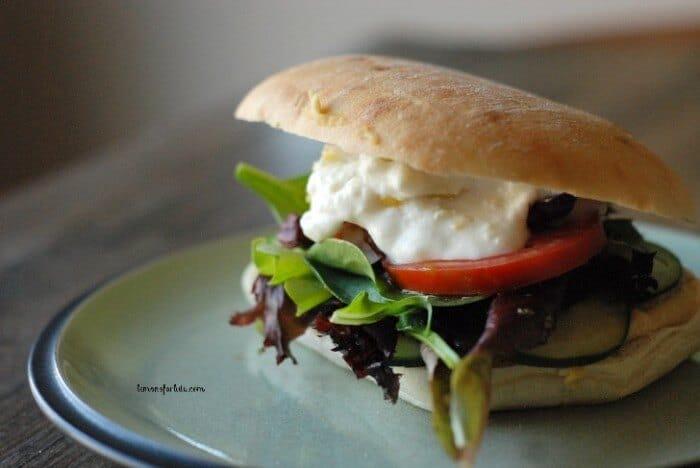 Vegetarian Sandwiches with a Greek flair! Inside you'll find hummus, veggies, feta and tzitziki sauce! www.lemonsforlulu.com