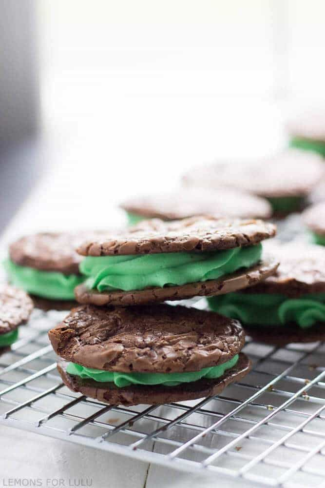 These mint chocolate cookies are made are rich and delicious with a thick minty buttercream in the center! www.lemonsforlulu.com