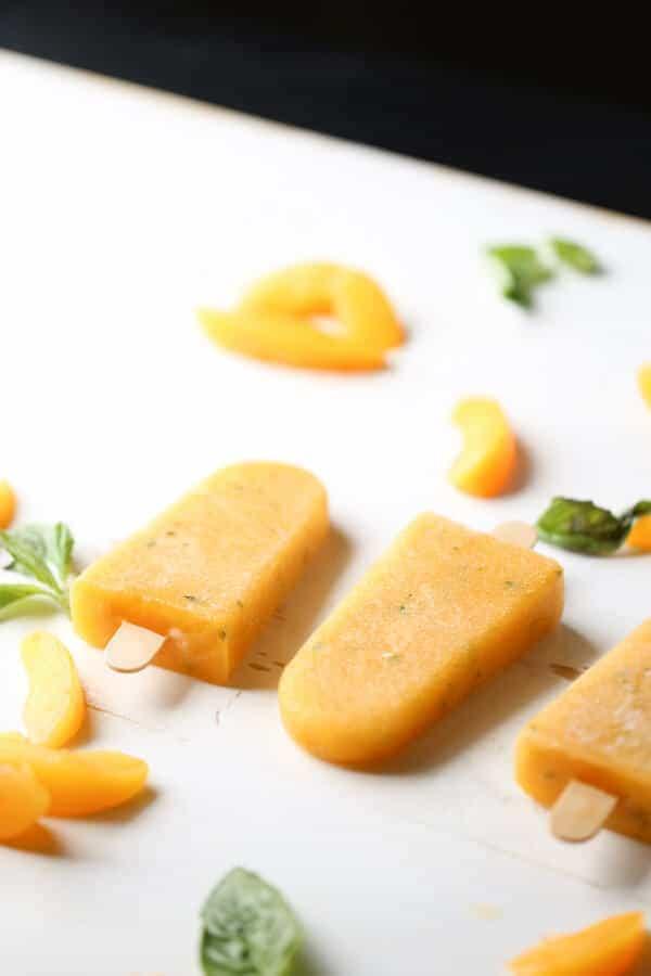 Peaches and basil make the perfect pair in this easy margarita recipe! lemonsforlulu.com