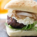 Everyone loves a good cheeseburger recipe! This one beats them all with it's thick savory beef patty, creamy Boursin cheese and soft, tender caramelized onion! Perfect for any BBQ! lemonsforlulu.com