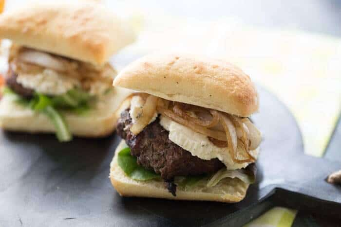 You will be blown away by these cheeseburgers! They start with a beef patty that has been seasoned with fresh herbs. Then they grilled to perfection and topped with a creamy Boursin cheese and flavorful caramelized onions! This cheeseburger recipe is gourmet tasting but easy to prepare! lemonsforlulu.com