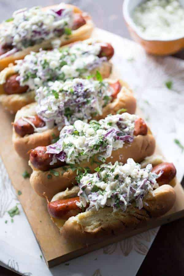 Flavorful andouille sausage is covered in a creamy, cool blue cheese coleslaw! lemonsforlulu.com