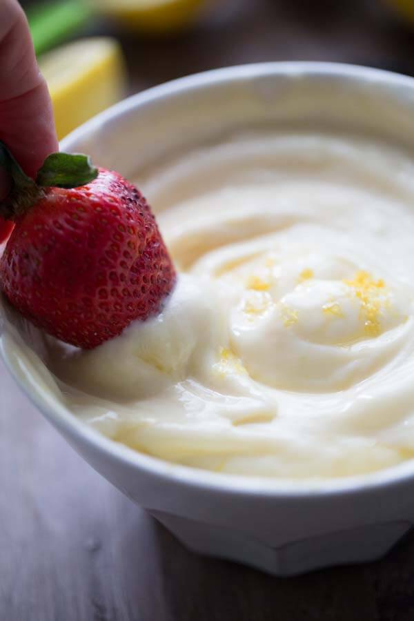 A creamy fruit dip recipe that is so simple you won't believe it! Homemade lemon curd and honey flavored yogurt combine for a simple, sweet fruit dip recipe! lemonsforlulu.com #AusseStyle #Ad