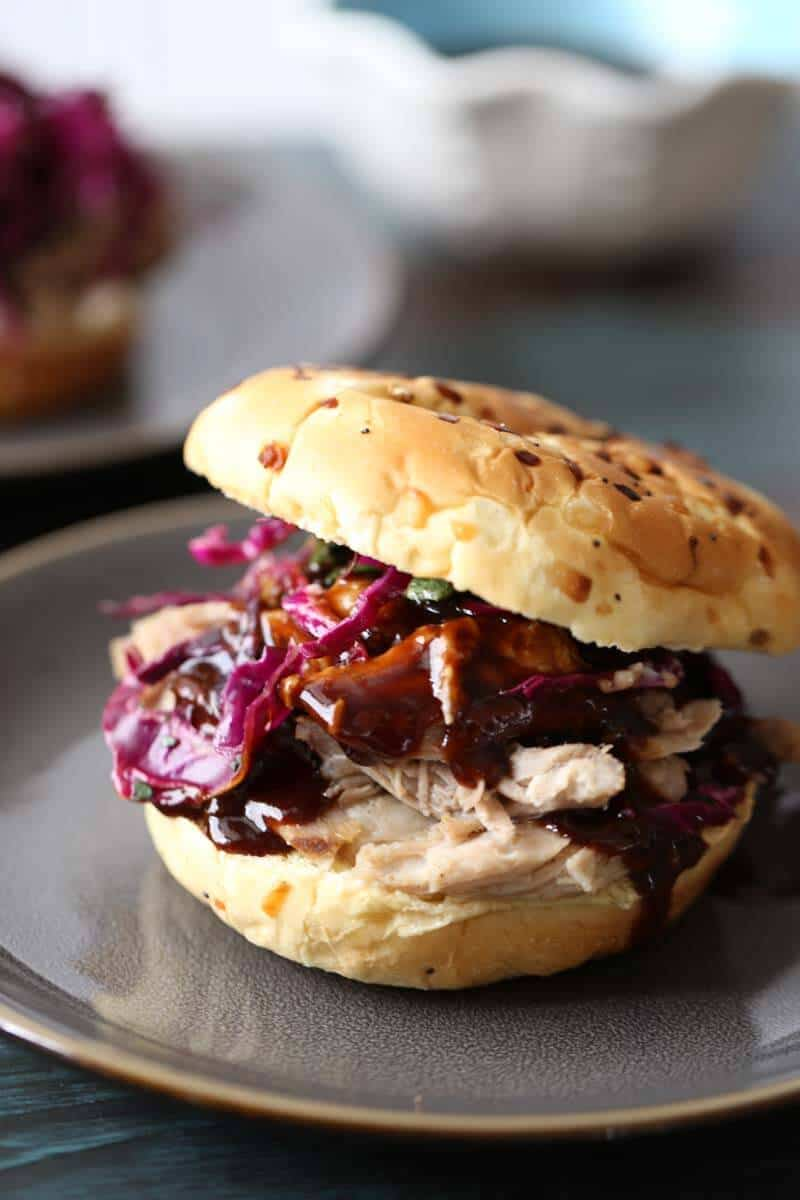 This pulled pork recipe is fulled with Asian flavor. The bbq sauce is touched with ginger that is balanced perfectly by the tangly slaw. The wasabi mayo rounds out the flavors. lemonsforlulu.com