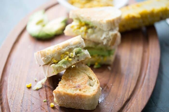 Creamy avocado and smokey grilled corn marry together in this easy grilled sandwich! lemonsforlulu.com