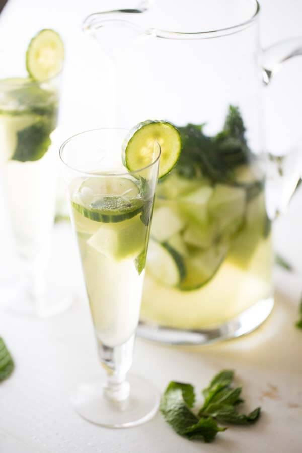Cool cucumbers and sweet honey dew melon makea this white sangria so pleasingly refreshing! lemonsforlulu.com
