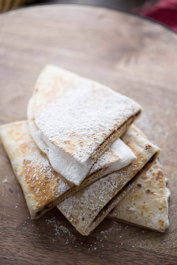 Indoor S'mores with a twist!  This quesadilla recipe features all the flavors of a classic  S'more tucked inside a tortiilla! lemonsforlulu.com