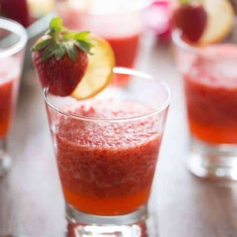 Refreshingly delicious strawberry rickey mocktails on a wooden table.