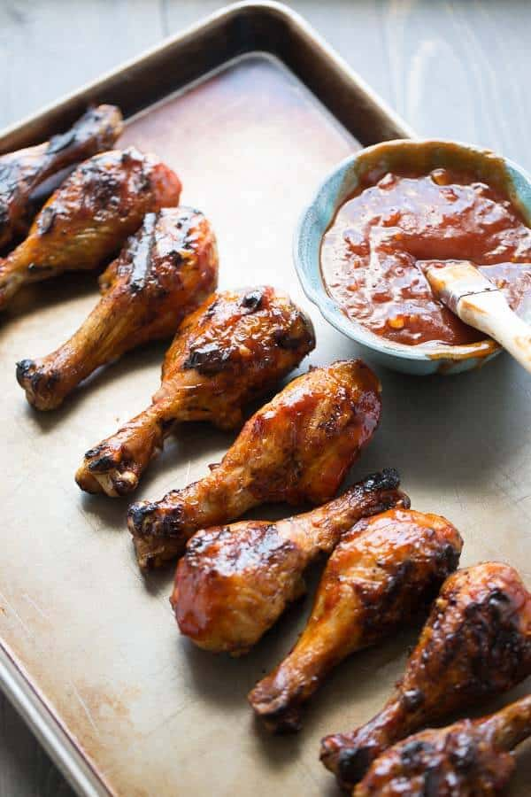 Grilled chicken drumsticks are covered in a spicy sweet chili garlic bbq sauce. lemonsforlulu.com