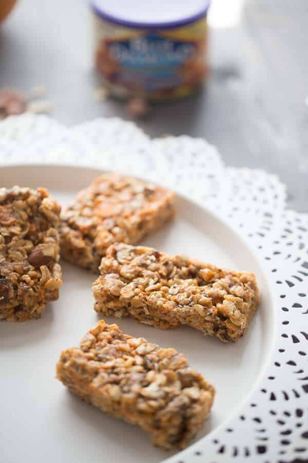 Soft, chewy, homemade granola bars with peanut butter, oats, honey, and salted caramel almonds is easy to prepare and makes an excellent snack when you are on the go! lemonsforlul.com