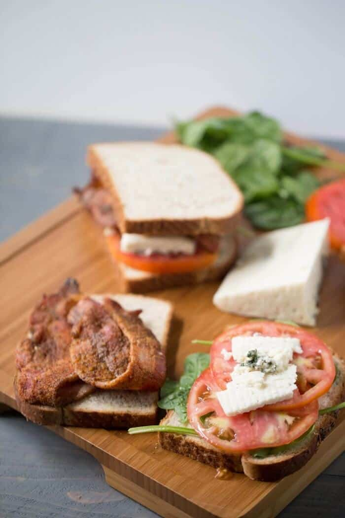 This BLT sandwich recipe will beat all others! It has bbq seasoned bacon and creamy blue cheese. The first bite will blow you away! lemonsforlulu.com