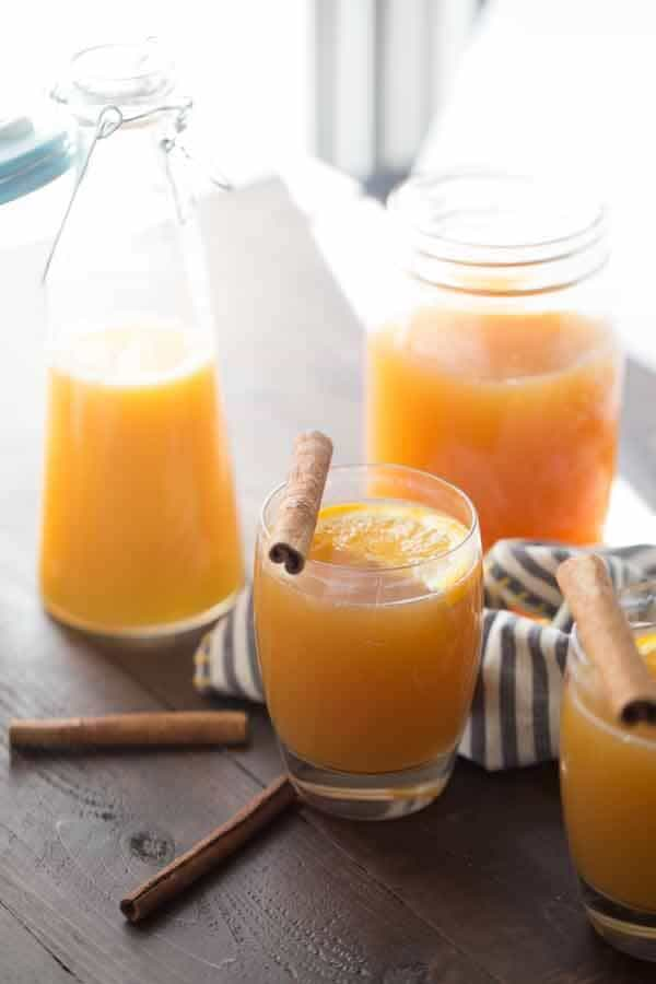 Hot apple cider, bourbon and a splash of juice; that's all thats needed for this belly-warming cocktail! lemonsforlulu.com