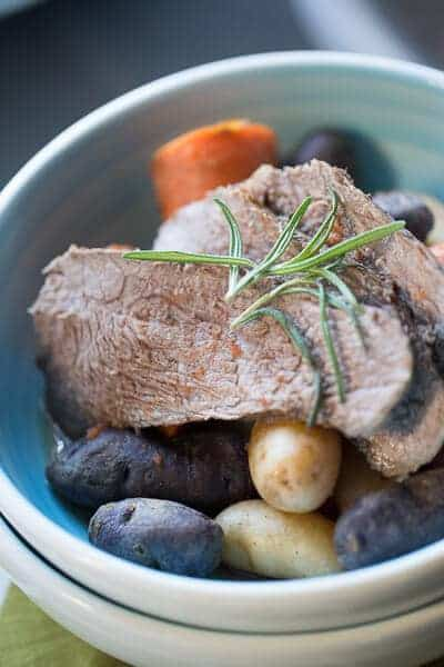 A simple, rustic crockpot pot roast with vegetables! Family food at it's best! lemonsforlulu.com