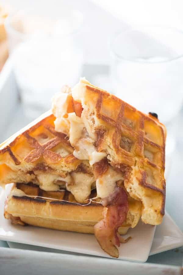 A simple waffle sandwich that is grilled with sweet apple butter, salty bacon and creamy fontina cheese! lemonsforlulu.com