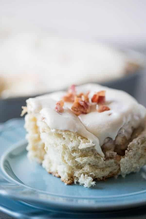 Homemade bacon cinnamon rolls with a sweet maple frosting. lemonsforlulu.com