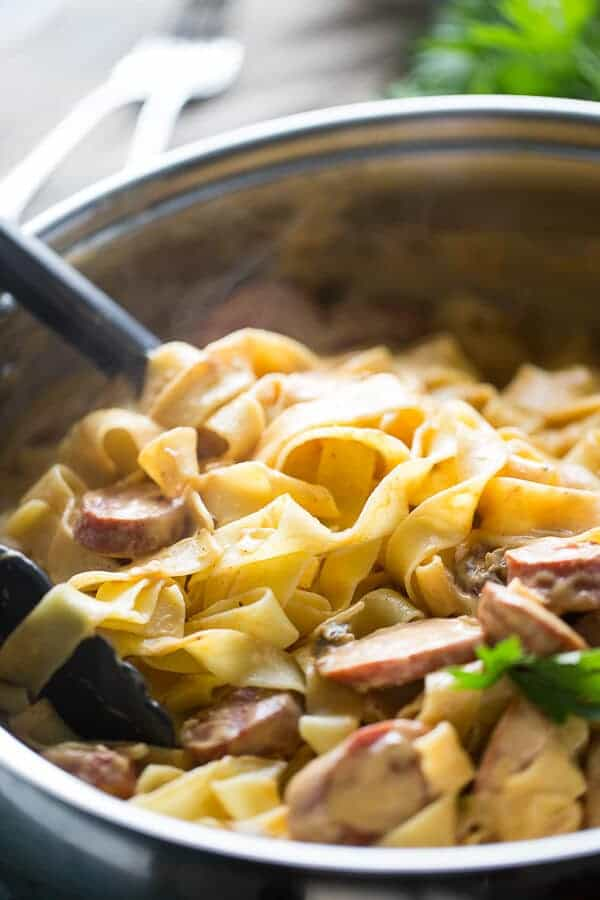 A spiced pumpkin pasta sauce coates thick pasta that is lightly tossed with smoked sausage. lemonsforlulu.com