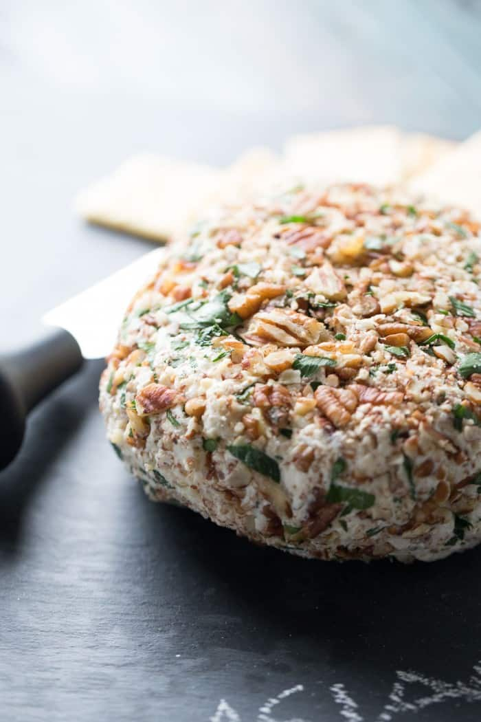 This cheese ball recipe with cream cheese, Greek yogurt, Asiago cheese and roasted garlic will be your go-to appetizer! lemonsforlulu.com