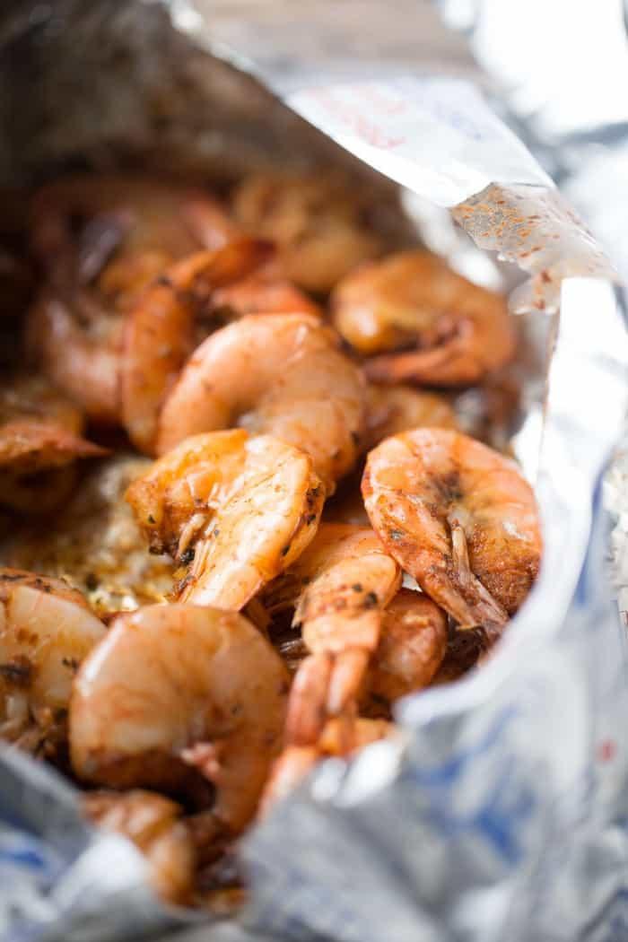 Cajun shrimp recipe over a simple mix of beans, sausage and quinoa! lemonsforlulu.com