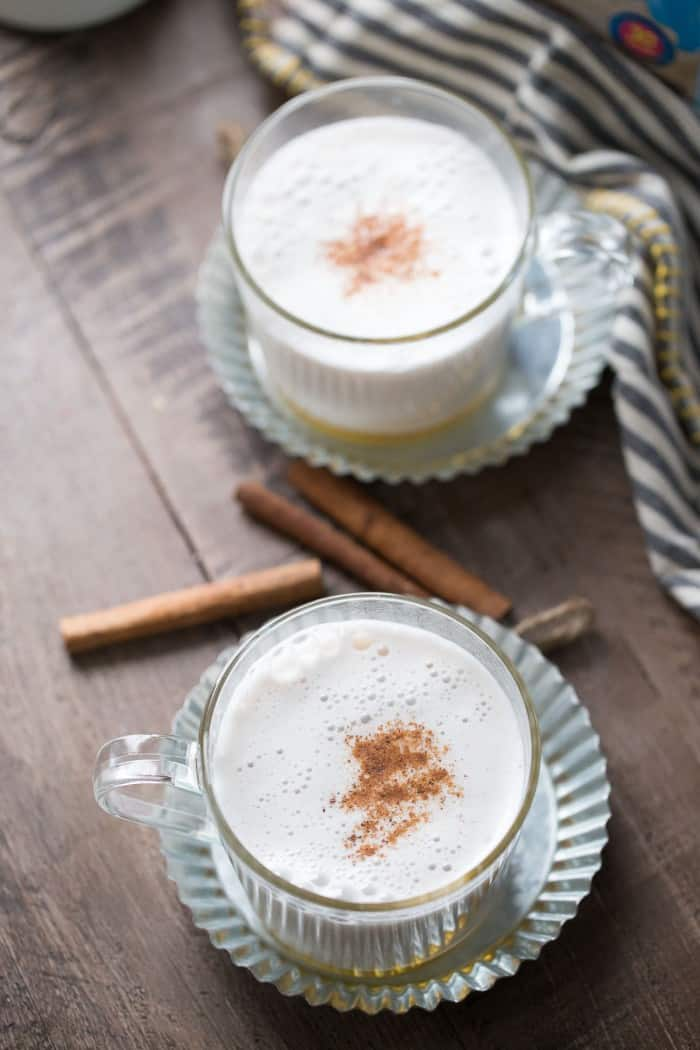 Soothe and comfort yourself with a warm glass of almond milk! Almond milk is infused with cinnamon , frothed and poured over honey! A simple and slightly sweet beverage that is so delicious! lemonsforlulu.com