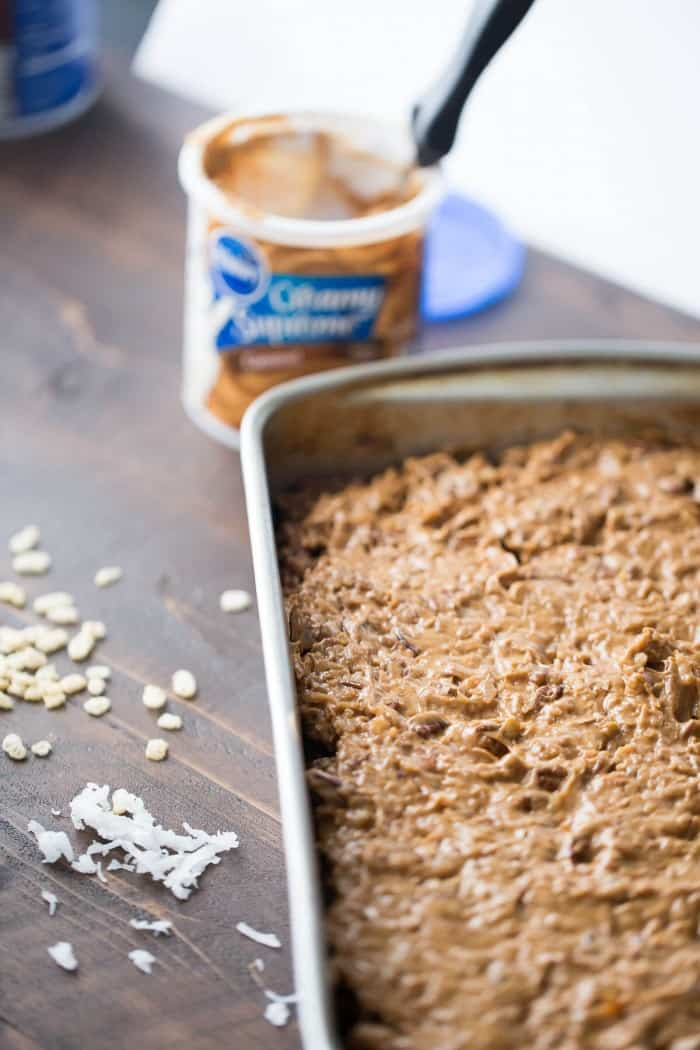 Chocolate frosting and German cake mix make these simple Scotcharoos a family pleasing dessert!