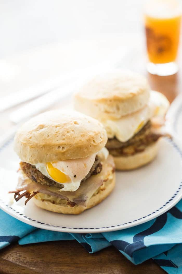 This breakfast sandwich recipe has everything you love about big Sunday style breakfasts; it as hash browns, cheese, biscuits, eggs and goetta!
