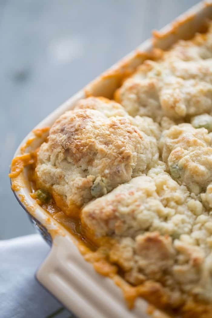 Creamy buffalo chicken cobber recipe is topped with savory blue cheese biscuits! This casserole is abosolute comfort food!