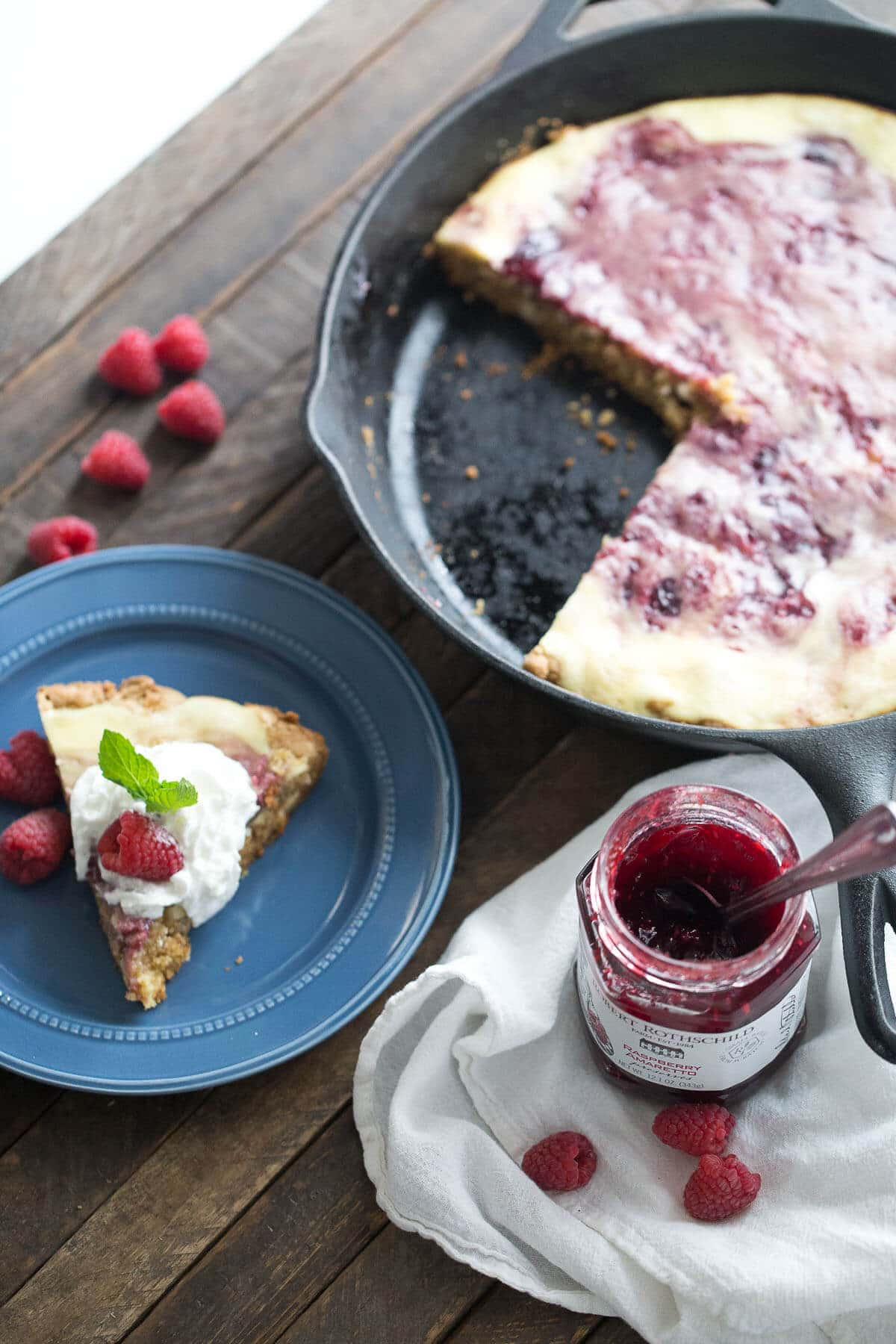 Love cheesecake? This raspberry amaretto cheesecake blondie is for you! The cheesecake layer is creamy and smooth and the blondie is soft and sweet! Such a; great combo!